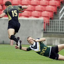 UVU's #10 Daniel Ottesen, right, tries to trip up Lindenwood's #15 Morgan Findlay during Division II college rugby semifinal action between Lindenwood and Utah Valley University Friday, May 18, 2012 at Rio Tinto Stadium. Lindenwood won 57-10.