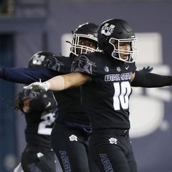 Utah State Aggies linebacker AJ Vongphachanh (10) celebrates a missed Brigham Young Cougars field goal in Logan on Friday, Oct. 1, 2021.