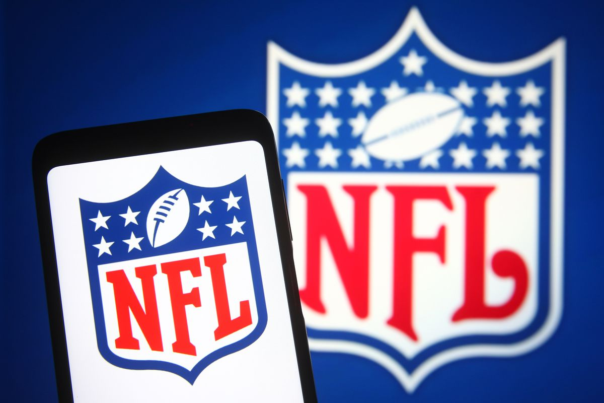 In this photo illustration, an NFL (National Football League...