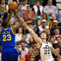 Jazz small forward Gordon Hayward (20) goes up to block a Draymond Green (23) shot during the first half of the NBA basketball game between the Utah Jazz and the Golden State Warriors at Energy Solutions Arena, Wednesday, Dec. 26, 2012.