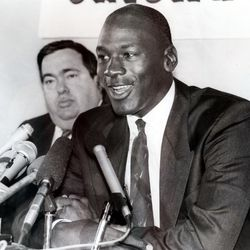 Jerry Krause, left, general manager of the Chicago Bulls, is shown with Bulls legend Michael Jordan in this Sept. 20, 1988 file photograph after Jordan agreed to an eight-year contract extension. (AP Photo/Mark Elias, file)