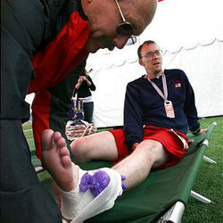 Park City Fire Department firefighter and emergency medical technician Ken Smith wraps Michael Harmon's ankle at the finish area of the Ragnar Relay Wasatch Back race in Park City on Saturday. Harmon, of American Fork, ran 4.8 miles on his twisted ankle.