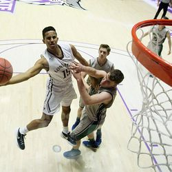 Lone Peak's Frank Jackson flips up a shot with Copper Hills' Porter Hawkins defending as they play Monday, Feb. 23, 2015, in the first round of the 5A boys basketball tournament at Weber State in Ogden.