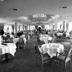 Waiters prepare tables in the magnificent Sky Room of the hotel. The room provides a panoramic sky view of Salt Lake City. June 2, 1967.