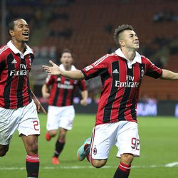AC Milan forward Stephan El Shaarawy, right, celebrates with his teammate midfielder Urby Emanuelson, of the Netherlands, after scoring during the Serie A soccer match between AC Milan and Cagliari at the San Siro stadium in Milan, Italy, Wednesday, Sept. 26, 2012.