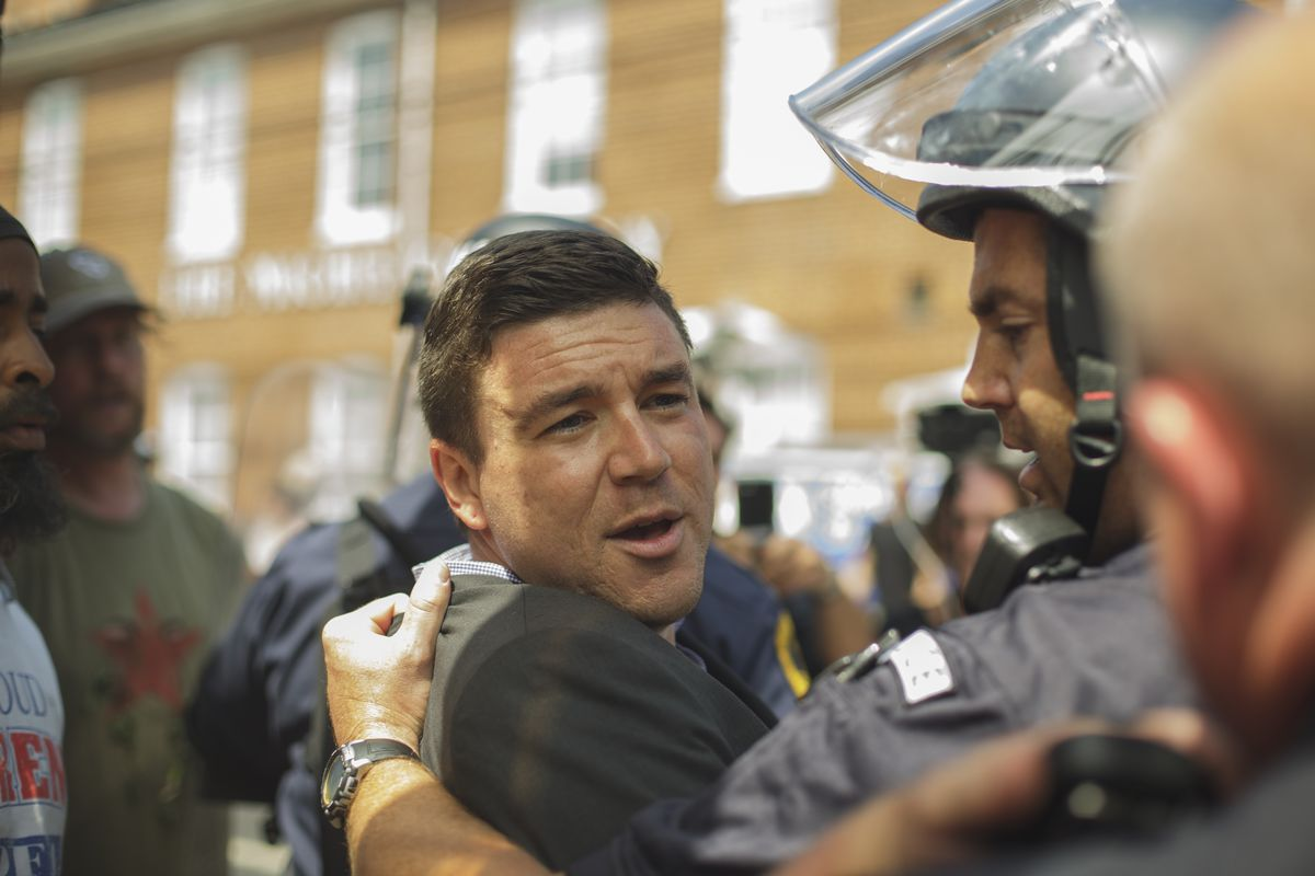 Jason Kessler, who helped organize Saturday's Unite the Right march, had to be escorted by police from his own press conference Sunday.