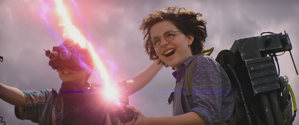 Mckenna Grace with a proton pack in Ghostbusters: Afterlife