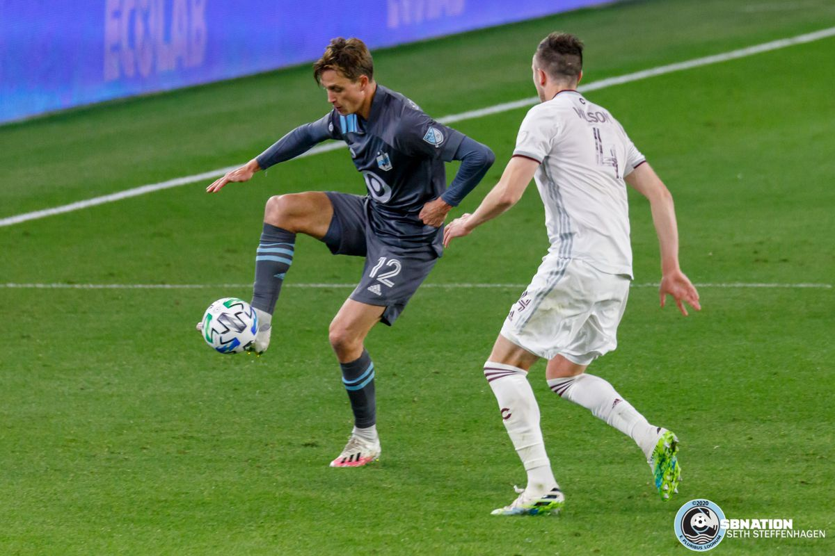 October 28, 2020 - Saint Paul, Minnesota, United States - Minnesota United forward Aaron Schoenfeld (12) traps the ball as Colorado Rapids defender Danny Wilson (4) closes in during the match at Allianz Field.