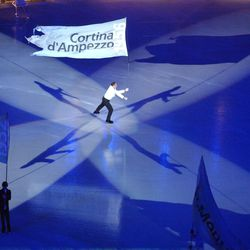 A lone skater carries a flag during the Salt Lake 2002 Winter Games opening ceremony at the University of Utah's Rice-Eccles Stadium on Friday, Feb. 8, 2002.