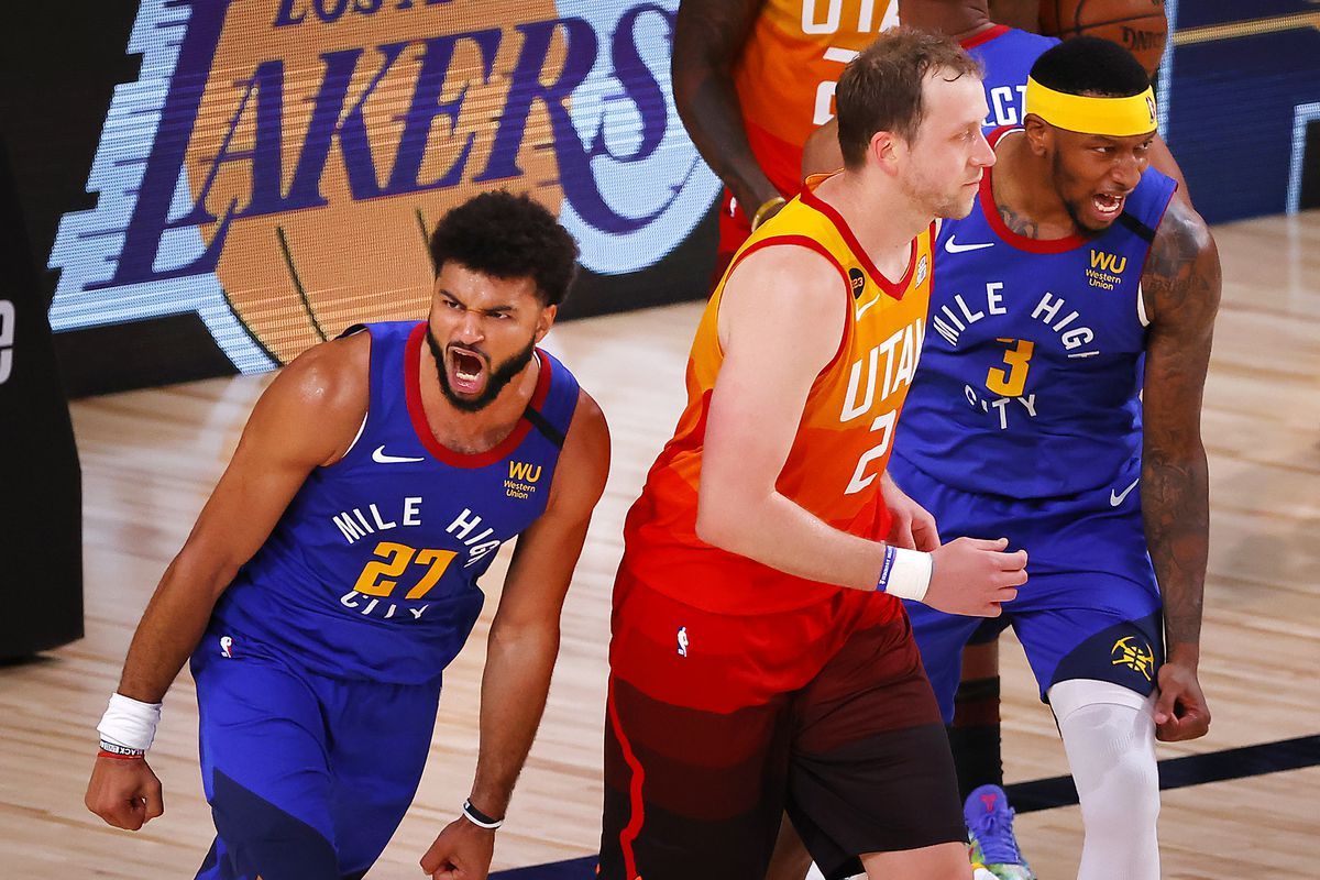 Jamal Murray of the Denver Nuggets reacts after a basket with Torrey Craig of the Denver Nuggets and as Joe Ingles of the Utah Jazz looks on during the fourth quarter at The Arena at ESPN Wide World Of Sports Complex.