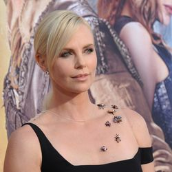Charlize Theron attended with some creepy crawlies.