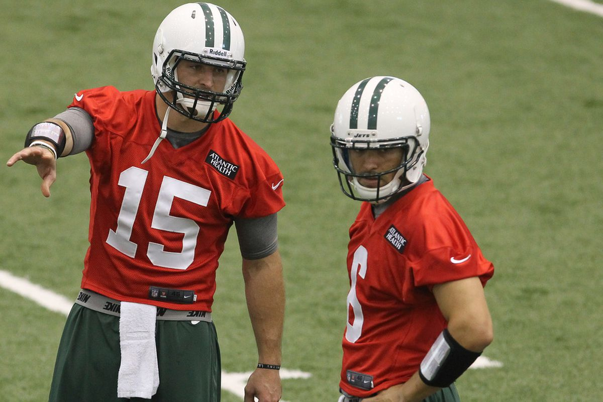 June 12, 2012; Florham Park, NJ, USA; New York Jets quarterback Mark Sanchez (6) and New York Jets quarterback Tim Tebow (15) during New York Jets Minicamp at the Atlantic Health Training Center. Mandatory Credit: Ed Mulholland-US PRESSWIRE