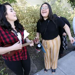 """Jordan Ray and Alicia Ruiz sing while waiting in line for """"American Idol"""" auditions outside of the Northwest Community Center in Salt Lake City on Thursday, Aug. 29, 2019."""
