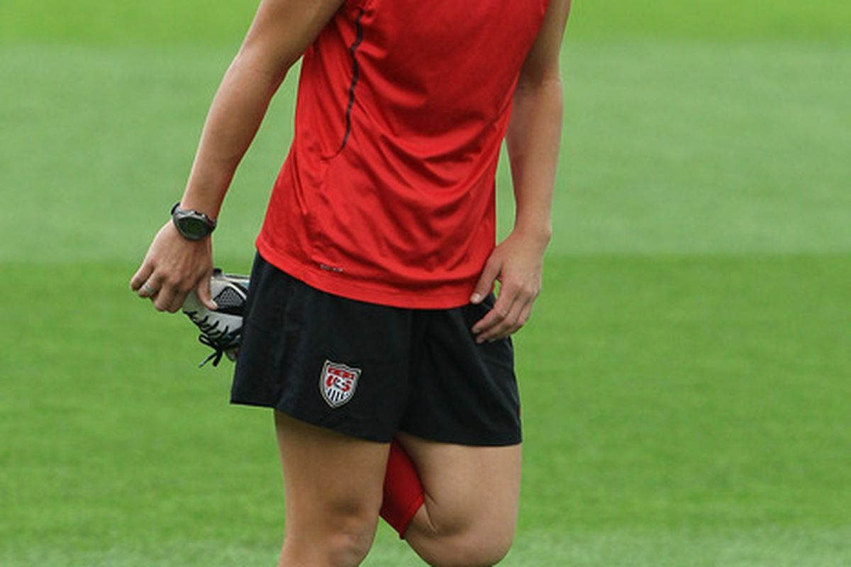 FRANKFURT AM MAIN, GERMANY - JULY 16: Abby Wambach stretches during the USA team training session at FIFA World Cup Stadium Frankfurt on July 16, 2011 in Frankfurt am Main, Germany. (Photo by Christof Koepsel/Getty Images)