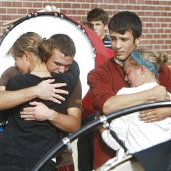 Members of the American Fork Marching Band comfort each other after their band practice for an upcoming competition and for the funeral of American Fork High band instructor Heather Christensen, who was killed in a bus accident on their way back from a band competition in Idaho over the weekend.