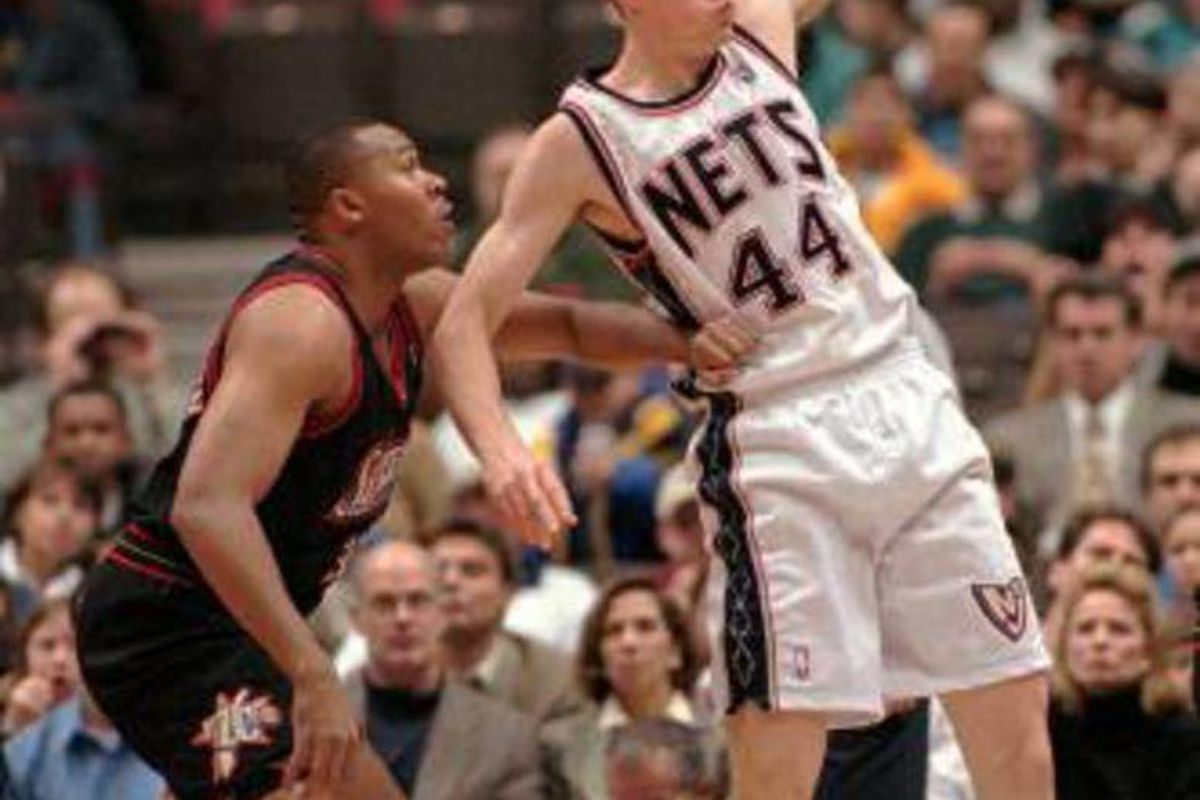 New Jersey Nets' Keith Van Horn (44) pulls down a pass as he is hand checked by Philadelphia 76ers' Clarence Weatherspoon during the first half Friday night, Dec. 5, 1997, in East Rutherford, N.J. Van Horn scored 11 points in his pro debut as the Nets bea