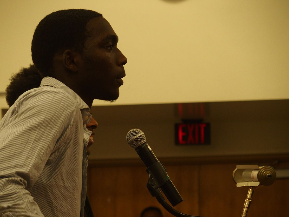 Patrick Johnson, a senior at G.W. Carver College and Career Academy, speaks to school board members about bus passes for high school students.