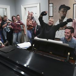 Actress Kristin Chenoweth sings as John Sergeant plays the piano during the Encircle SLC weekly music night in Salt Lake City on Thursday, Oct. 17, 2019. Encircle provides programs and other services for LGBTQ individuals to find information and support.