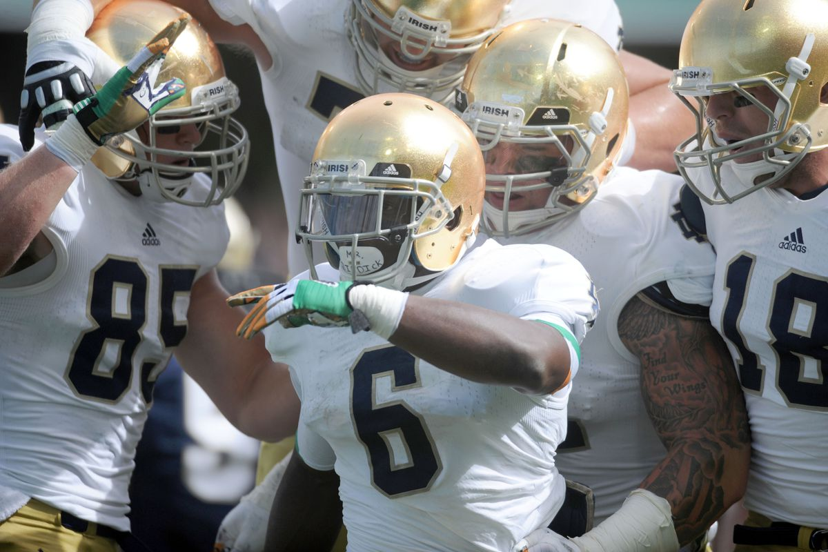 DUBLIN, IRELAND - SEPTEMBER 01: Theo Riddick #6 of Notre Dame celebrates after scoring the first touchdown during the Notre Dame vs Navy game at Aviva Stadiu, on September 1, 2012 in Dublin, Ireland. (Photo by Barry Cronin/Getty Images)