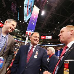Utah Gov. Gary Herbert, center, talks with Matthew Moench and  Justin Harding during the final night of the National Republican Convention in Cleveland on Thursday, July 21, 2016.