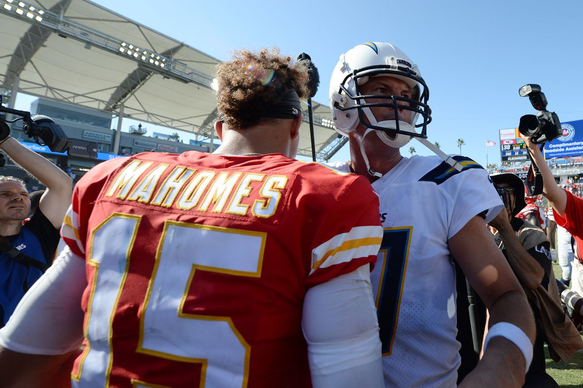 Kansas City Chiefs quarterback Patrick Mahomes meets with Los Angeles Chargers quarterback Philip Rivers following the Chiefs 38-28 victory at StubHub Center in Carson, California.