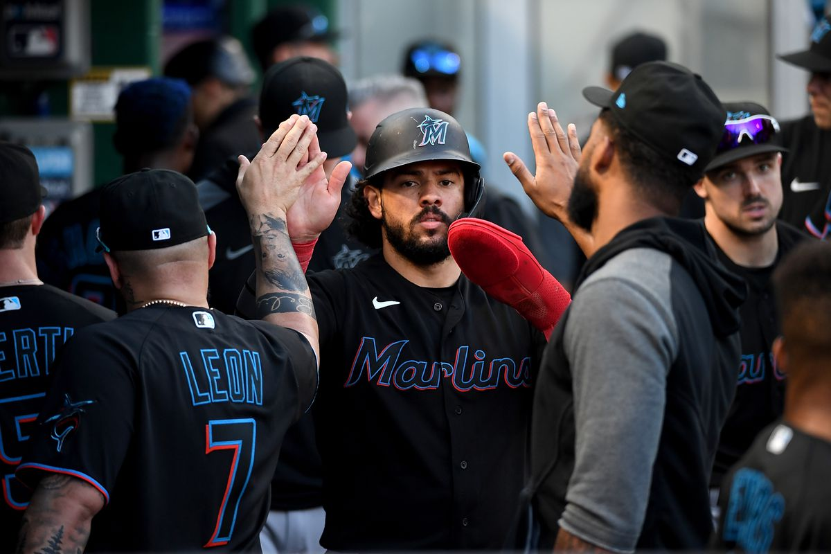 Jorge Alfaro #38 of the Miami Marlins celebrates with teammates in the dugout after coming around to score on a sacrifice fly ball by Isan Diaz #1 in the tenth inning during the game against the Pittsburgh Pirates at PNC Park