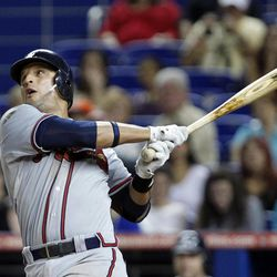 Atlanta Braves' Martin Prado watches his ball after hitting a single that scored Jason Heyward during the eighth inning of a baseball game against the Miami Marlins, Monday, Sept. 17, 2012, in Miami. The Braves won 7-5.