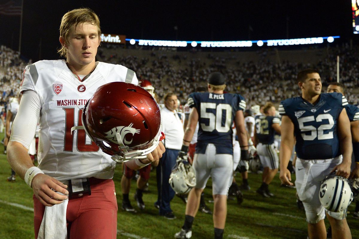 Aug 30, 2012; Provo, UT, USA; Washington State Cougars quarterback Jeff Tuel (10) walks off the field after losing to the Brigham Young Cougars 30-6 at Lavell Edwards Stadium. Mandatory Credit: Jake Roth-US PRESSWIRE
