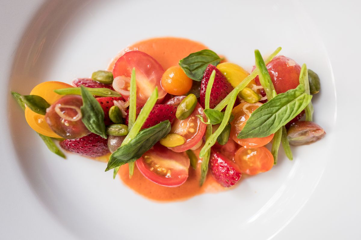 A salad of tomatoes and strawberries at Le Coucou