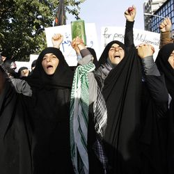 Iranian protestors chant slogans in front of the French Embassy during a demonstration to condemn a French magazine caricaturing prophet Muhammad in Tehran, Iran, Sunday, Sept. 23, 2012.