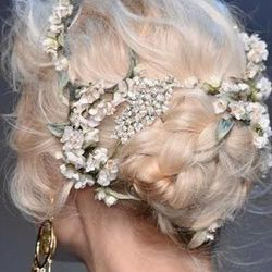 """Stylist Brittany Brudzinki at <a href=""""http://maxinesalon.com/"""">Maxine Salon</a> [712 North Rush Street] [Photos: Pinterest] says:""""Whimsical, soft, textured hair is the theme for the 2014 wedding season. This year, women are choosing a more romantic, <str"""