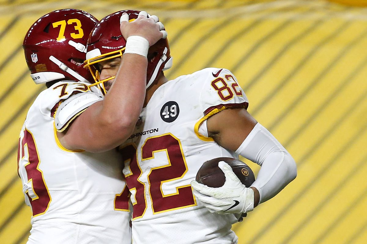 Logan Thomas #82 of the Washington Football Team celebrates with teammate Chase Roullier #73 following a touchdown catch during the second half of their game against the Pittsburgh Steelers at Heinz Field on December 07, 2020 in Pittsburgh, Pennsylvania.