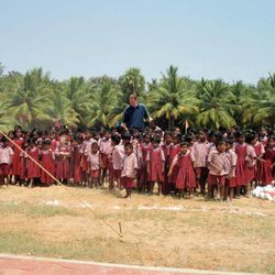 Former NBA player Shawn Bradley among a group of children at the Rising Star Outreach campus in Thottanaval, India.
