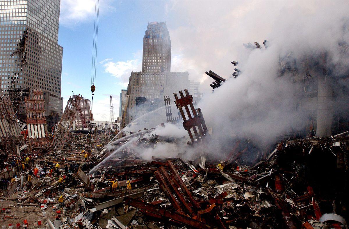 Remnants of the World Trade Center smolder on September 14, 2001.