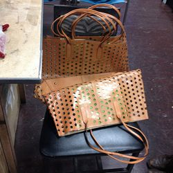 $100 for small perforated leather totes