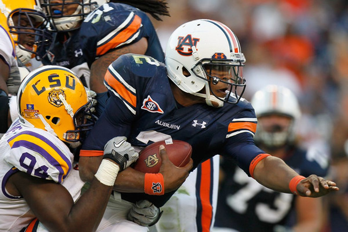 AUBURN AL - OCTOBER 23:  Quarterback Cameron Newton #2 of the Auburn Tigers is tackled by Kendrick Adams #37 of the LSU Tigers at Jordan-Hare Stadium on October 23 2010 in Auburn Alabama.  (Photo by Kevin C. Cox/Getty Images)