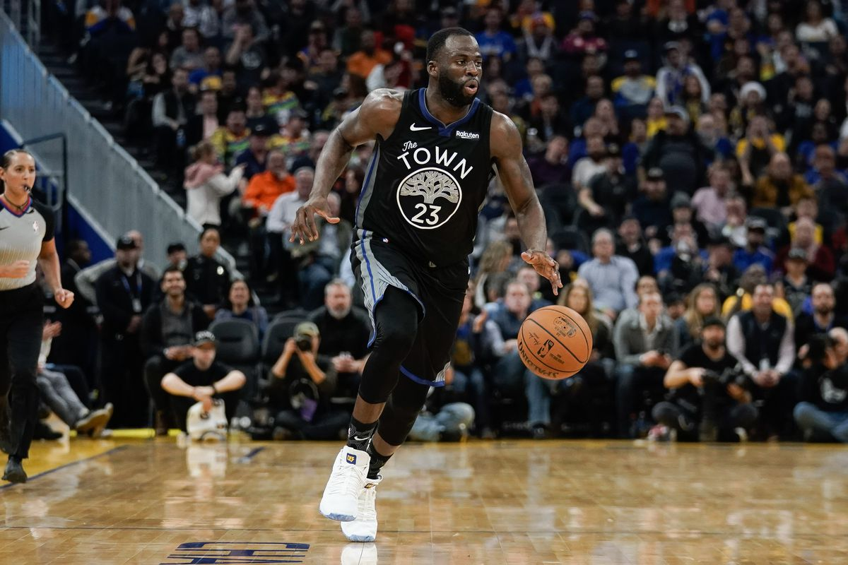 Golden State Warriors forward Draymond Green controls the ball against the New York Knicks during the third quarter at Chase Center.
