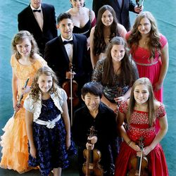 (Rear row, left to right) Alexander Cheng, Sally Drutman and William Yavornitzky. (Orange dress) Ashley Fleming, Jeremy David Lewis, Rachel Aina Call, Erika Hubbard and Mischael Ann Staples. (Blue and silver dress, left) Hannah Jean Baker, Soonyoung Kwon and McCall Andersen. These musicians have been selected to perform in this year's Salute to Youth concert. These musicians, pictured July 30 at Abravanel Hall, have been selected to perform in this year's Salute to Youth concert.