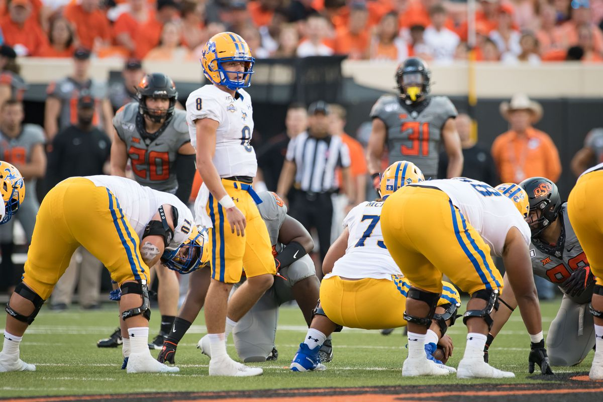 McNeese State Cowboys quarterback Cody Orgeron looks to the sidelines during the second quarter in the game against the Oklahoma State Cowboys at Boone Pickens Stadium.