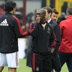 AC Milan midfielder Clarence Seedorf, of the Netherlands,  gestures prior to the start of a Serie A soccer match between AC Milan and Genoa, at the San Siro stadium in Milan, Italy, Saturday, April 14, 2012. The Italian football federation has called off all league games this weekend after the death of Livorno midfielder Piermario Morosini during a Serie B match against Pescara, in Pescara, central Italy, Saturday, April 14, 2012.