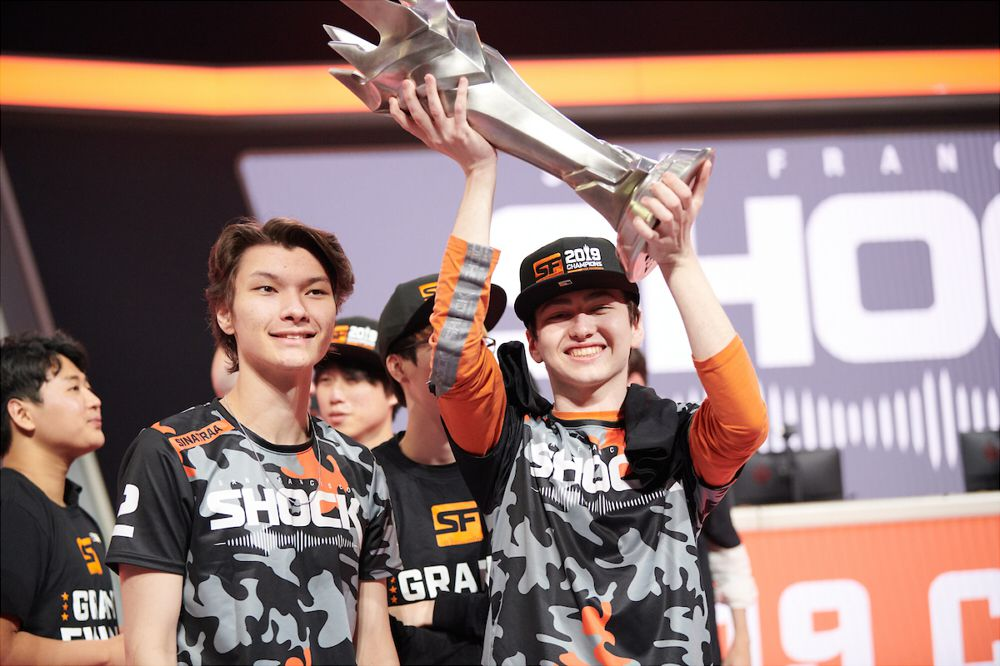 Overwatch League - the San Francisco Shock hold the trophy high on stage at the Wells Fargo center in Philadelphia