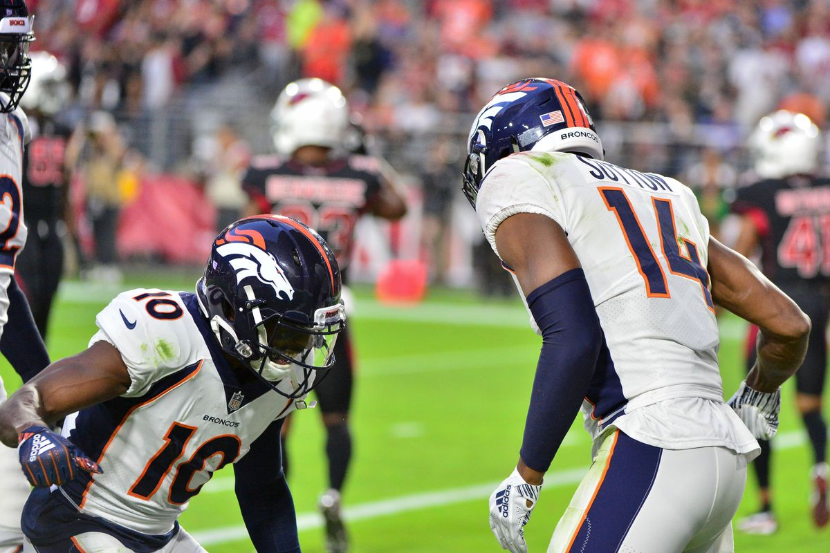 Denver Broncos wide receiver Emmanuel Sanders and wide receiver Courtland Sutton celebrate after connecting for a touchdown during the first half against the Arizona Cardinals at State Farm Stadium.