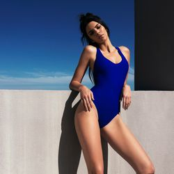 Kendall wears the Baywatch-esque tape detail swimsuit.