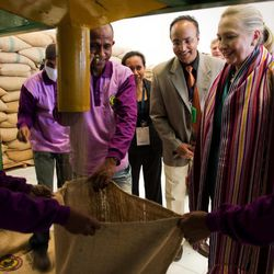U.S. Secretary of State Hillary Rodham Clinton, 2nd right, watches coffee beans come out of a sorter during a tour of the Timor Coffee Cooperative in Dili, East Timor Thursday, Sept. 6, 2012. U.S. Secretary of State Hillary Rodham Clinton is in East Timor to offer the small half-island nation support as it ends its reliance on international peacekeepers.