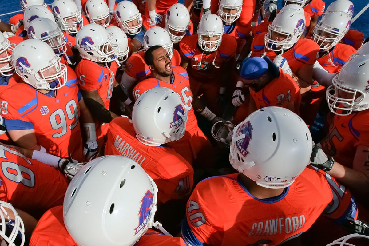 BOISE, ID - NOVEMBER 12:  Jarrell Root #96 of the Boise State Broncos psyches up his team before the game against the TCU Horned Frogs at Bronco Stadium on November 12, 2011 in Boise, Idaho.  (Photo by Otto Kitsinger III/Getty Images)