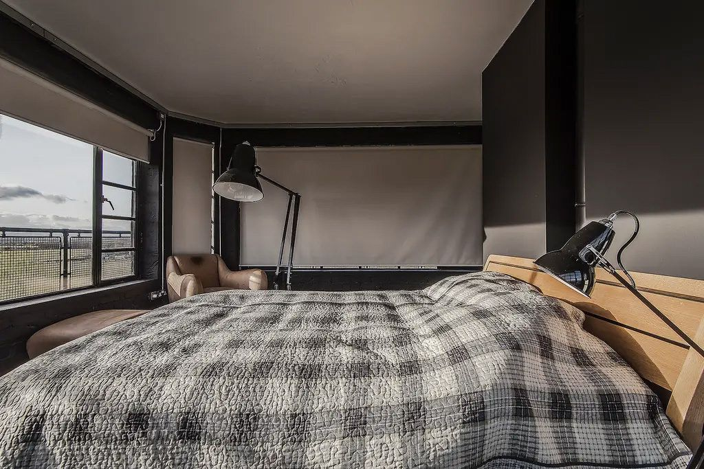 Bed with plaid duvet