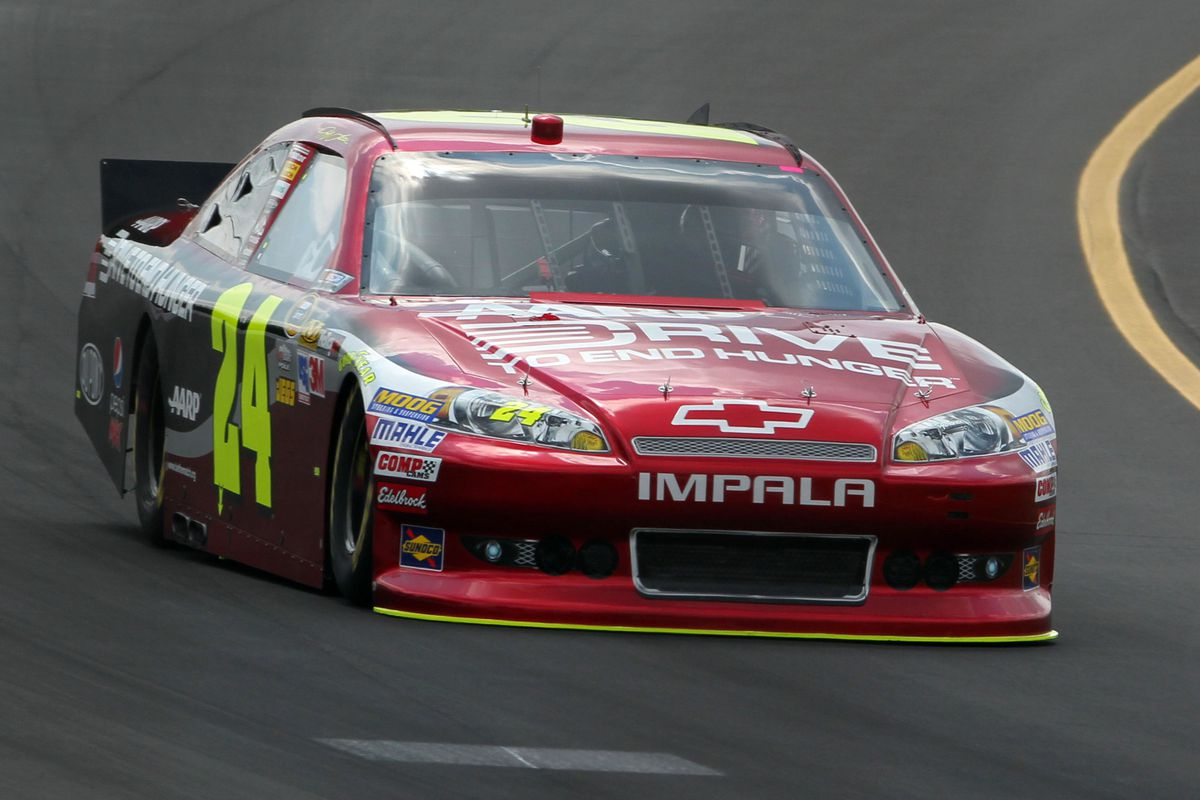 Aug 4, 2012; Long Pond, PA, USA;   NASCAR Sprint Cup Series driver Jeff Gordon (24) during qualifying for the Pennsylvania 400 at Pocono Raceway.  Mandatory Credit: Anthony Gruppuso-US PRESSWIRE
