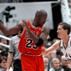 Chicago Bulls' Michael Jordan pulls the ball out of reach of Utah Jazz guard Jeff Hornacek, right, during third quarter action in Game 2 of the NBA Finals in Salt Lake City, Friday, June 5, 1998. (AP Photo/Mark J. Terrill)