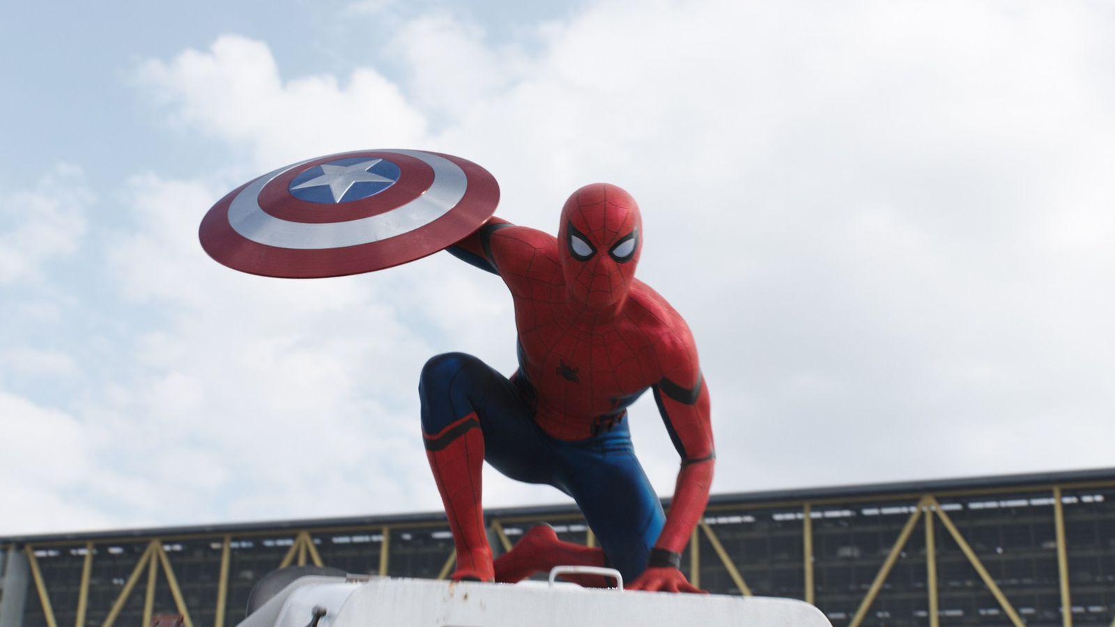 Tom Hollands Spider-man in civil war holding captain america's shield