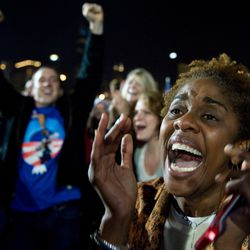 Supporters of Barack Obama react as television networks projected Obama the winner of the election. | Saul Loeb/AFP/Getty Images